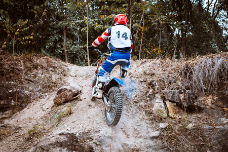 Trials motorcycle while competition in nature park Stock Photo