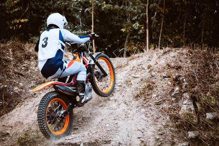 Trials motorcycle while competition in nature park 版權商用圖片