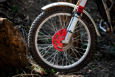 Close-up of wheel trials motorcycle while competition in nature park