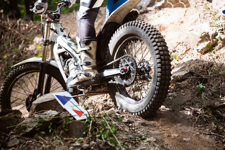 Trials motorcycle while competition in nature park, close up shot