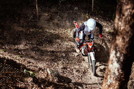 Trials motorcycle while competition in nature park 스톡 콘텐츠