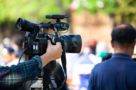 Video camera working with covering an event Stock Photo