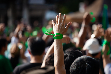 People raised hand air fighting for protest