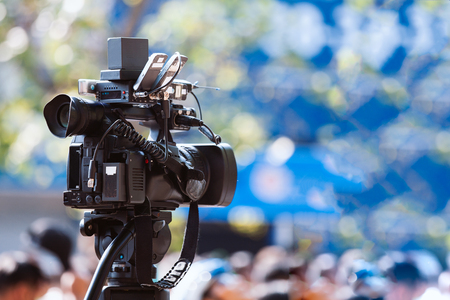 Video camera working with covering an event 스톡 콘텐츠