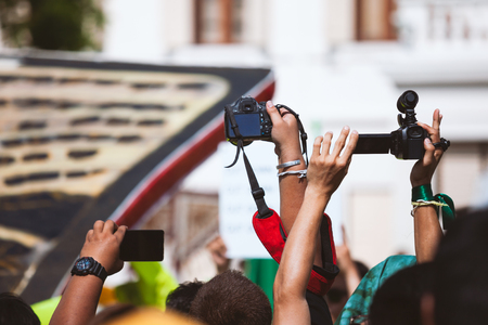 Camera and smartphone working with covering an event Stock Photo