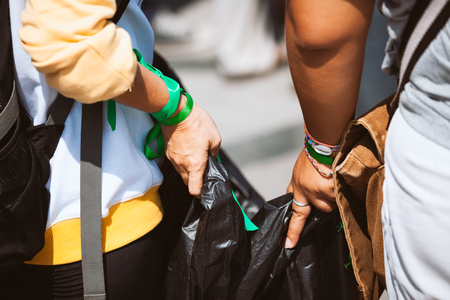 Women hands holding garbage bag