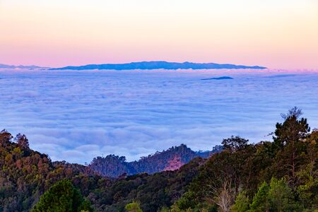 Mountains landscape with fog under morning sky 版權商用圖片