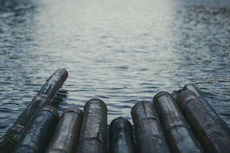 Close up of some part bamboo raft on the lake. Color tone in emotion feeling negative.