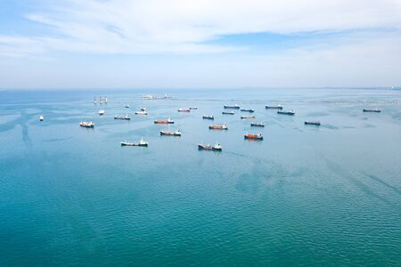 Aerial view from drone, Oil tanker ships off the coast in beautiful peaceful environment, professional business logistics and transportation of energy fuels.