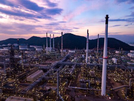 Aerial view, Oil refinery industrial plant at twilight. Professional energy business