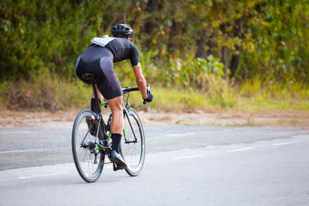 Professional cyclist during the cycling race. Shot in back - Image