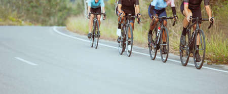 Group of professional cyclists during the cycling race. Shot in front - Image