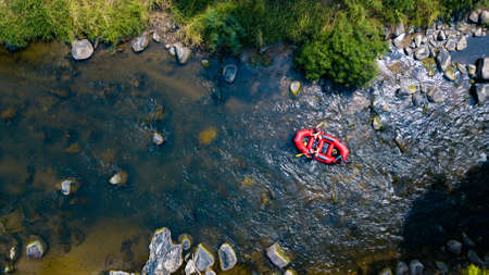 Aerial view, Sportman team are rafting on the river turbulent flow. Extreme and enjoyment sport. 免版税图像