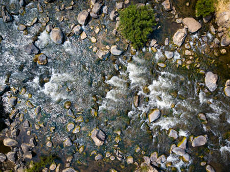 Aerial view and top view the river turbulent flow. Beautiful natural backdrop. 免版税图像