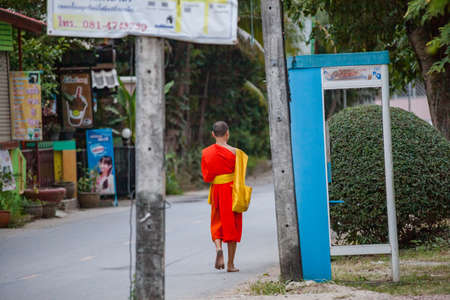 NOVEMBER 27, 2016 MAE SOT, THAILAND - monk with orange robe walking in the street in mae sot Thailand 에디토리얼