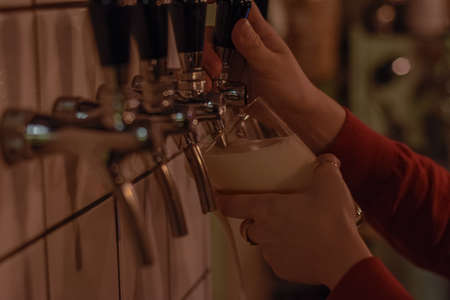 GIRL SERVING A DRAFT BEER IN A GLASS