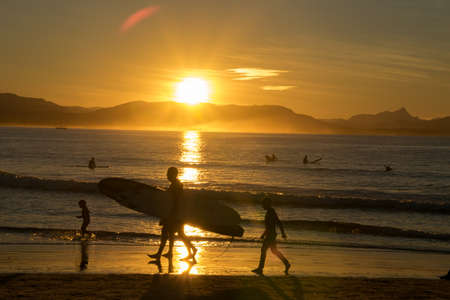 surfers on the beach, golden sunset view from NSW, Australia, Sydney 2018