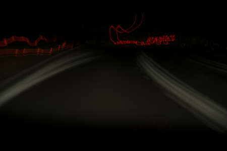 Abstract night road and velocity from a road trip, lights blur and shapes