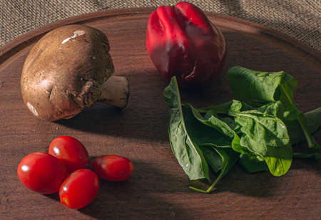Gastronomy photography Vegetables on wooden plate and brown background