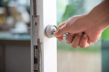 Opening the door with a key Stock Photo