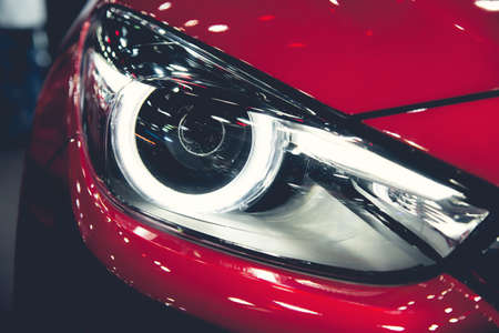 valeting: Headlight of a modern luxury car, auto detail,car care concept