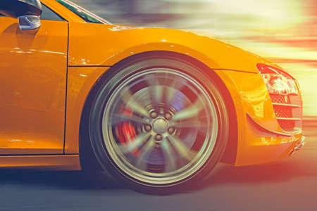 Sport car running at high speed on road