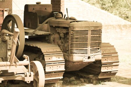 tractor that was forgotten in time, and being corroded by rust, machines that were once used a lot, today are for nothing