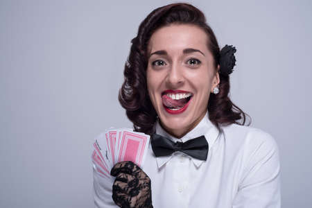 goofy: goofy girl with cards Stock Photo