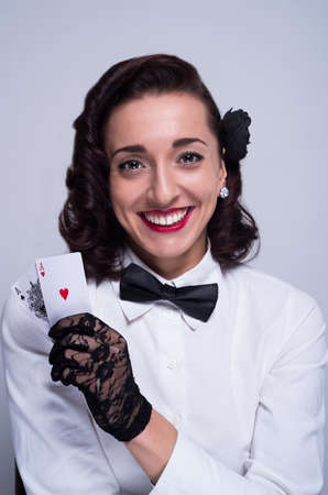 aces: smiling girl with pair of aces in her hand Stock Photo