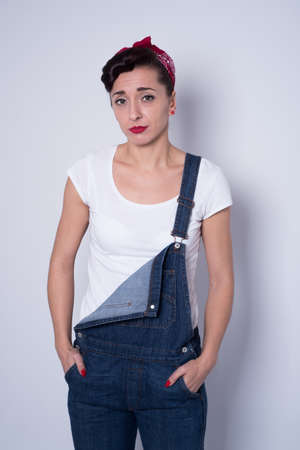 suspender: girl in suspender jeans with hands in pockets