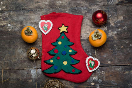 decore: christmas sock and decorations on table Stock Photo