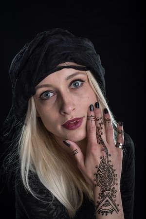 tatto: serious girl with henna tatto Stock Photo