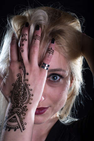 girl with henna tatto on her hand Stock Photo