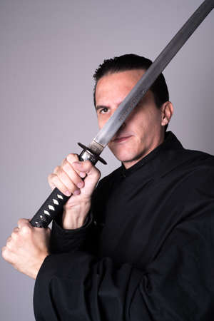 katana: samurai with katana near his face