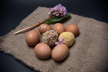 designe: easter eggs on black background and jute
