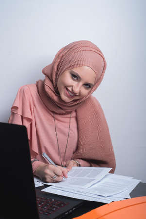 bussines people: Muslim woman working in office Stock Photo