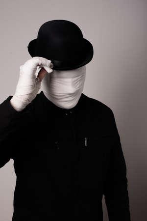 faceless: faceless man holding hat