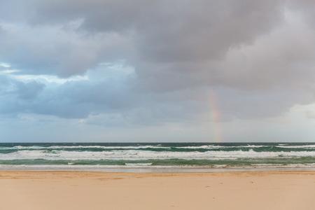 fraser island: Rainbow over the ocean on the coast of Fraser Island - largest sand island in the world, Queenland, Australia Stock Photo