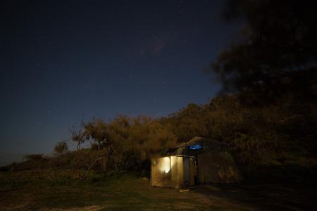 fraser island: lluminated tent on a starry night, Fraser Island, Australia Stock Photo