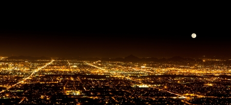 The Super Full Moon on May 5, 2012 over the city light of Phoenix Arizona. Photograph was taken from the top of South Mountain.  photo