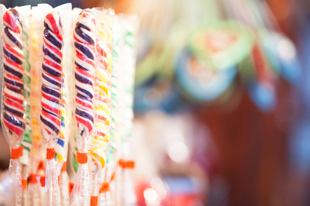 A row of colorful candy swirl sticks at a booth at a German Christmas market with room for text