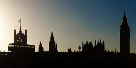 Cityscape silhouette at sunset including Big Ben and the Houses of Parliament in London England  photo