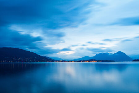 maggiore: Beautiful view of the blue cast in the sky and water on Lake Maggiore in northern Italy just before sunrise Stock Photo