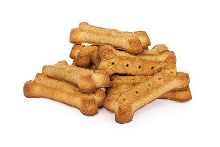 baked: A bunch of bone shaped dog treats isolated on white