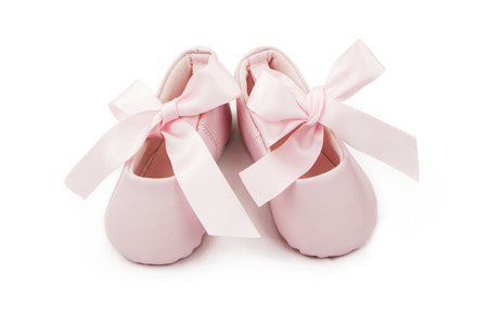 Pair of little pink baby ballerina bootoes with ribbons tied in a bow
