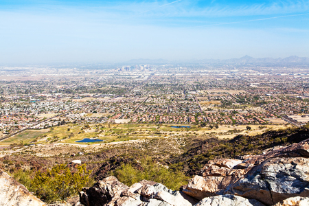 valley view: View from Dobbins Point on South Mountain in Phoenix, Arizona with rocks in foreground and cityscape in background