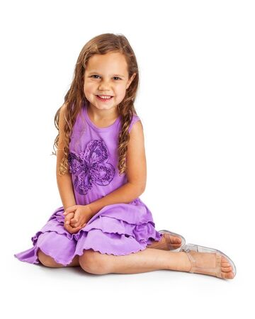 five year old: Pretty five year old girl with long blonde hair wearing purple dress sitting on white background