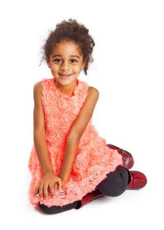 and four of the year: Pretty multi-cultural four year old girl sitting on a white studio background Stock Photo