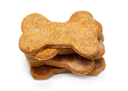 shaped: Tall stack of bone shaped natural peanut butter flavor dog cookies
