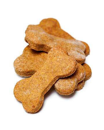 homemade: Bis pile of homemade healthy peanut butter flavor bone-shaped dog cookies Stock Photo